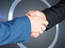 Composite image of male executives shaking hands. Male executives shaking hands against grey dot on technical background with pixels royalty free stock photos