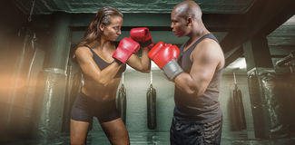Composite image of male and female boxer with fighting stance Royalty Free Stock Photos