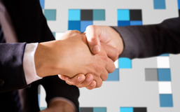 Composite image of male and female corporates shaking hands. Male and female corporates shaking hands against technical background with squars Royalty Free Stock Photo