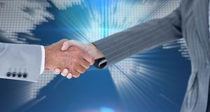 Composite image of male and female entrepreneurs shaking hands Royalty Free Stock Photography