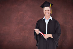 Composite image of a male graduate with his degree in hand Stock Photography