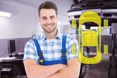 Composite image of male handyman standing arms crossed. Male handyman standing arms crossed against auto repair shop Stock Photography