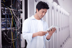 Composite image of male looking at his tablet computer Royalty Free Stock Photo
