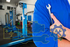 Composite image of male mechanic holding spanner on white background Stock Photography