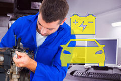 Composite image of male mechanic repairing car engine Stock Image