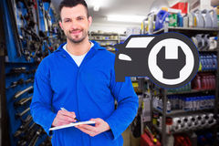 Composite image of male mechanic writing on clipboard Stock Photography