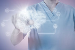 Composite image of male nurse touching invisible screen Royalty Free Stock Photos
