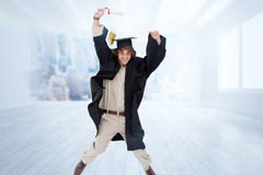 Composite image of male student in graduate robe jumping. Male student in graduate robe jumping against city scene in a room Stock Image