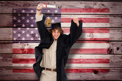 Composite image of male student in graduate robe jumping. Male student in graduate robe jumping against composite image of usa national flag Royalty Free Stock Photography
