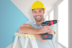 Composite image of male technician holding power drill on ladder. Male technician holding power drill on ladder against modern blue and white room Stock Photography