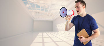 Composite image of male trainer yelling through the megaphone Stock Photo