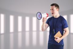 Composite image of male trainer yelling through the megaphone Stock Images
