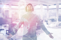 Composite image of man with arms outstretched while listening music 3d. Man with arms outstretched while listening music against interior of empty office 3d Royalty Free Stock Image