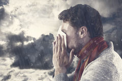 Composite image of man blowing nose on tissue royalty free stock image