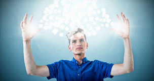 Composite image of man in blue shirt with arms raised 3d Royalty Free Stock Image