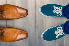 Composite image of man with canvas shoes on hardwood floor Royalty Free Stock Photo
