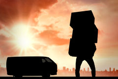 Composite image of man carrying pile of boxes Royalty Free Stock Image