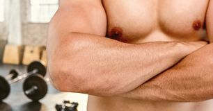 Composite image of man Fitness Torso against gym Royalty Free Stock Image