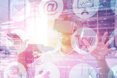 Composite image of man gesturing while using black virtual reality headset 3d Royalty Free Stock Images