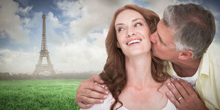 Composite image of man giving his partner a kiss Stock Images