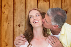 Composite image of man giving his partner a kiss Stock Photos