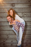 Composite image of man giving piggyback ride to woman Royalty Free Stock Photos