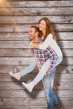 Composite image of man giving piggyback ride to woman Royalty Free Stock Photo