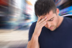 Composite image of man with headache Stock Images