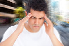 Composite image of man with headache Royalty Free Stock Image