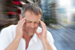 Composite image of man with headache Stock Photo