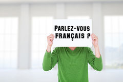 Composite image of man holding blank sign in front of face Royalty Free Stock Image
