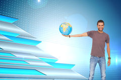 Composite image of man holding out a globe Royalty Free Stock Photography