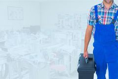 Composite image of man holding a toolbox. Digital composite of Composite image of man holding a toolbox Royalty Free Stock Photo