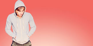 Composite image of  man in hood jacket thinking Royalty Free Stock Photography