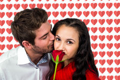 Composite image of man kissing his girlfriend Stock Photo