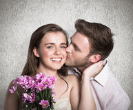 Composite image of man kissing woman as she holds flowers Stock Photos