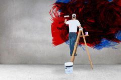 Composite image of man on ladder painting with roller Royalty Free Stock Images