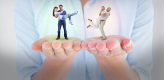 Composite image of man lifting up his girlfriend Stock Photos