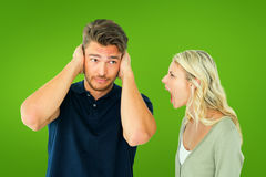 Composite image of man not listening to his shouting girlfriend Royalty Free Stock Photos