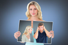 Composite image of man not listening to his shouting girlfriend Stock Image