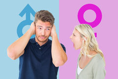Composite image of man not listening to his shouting girlfriend Royalty Free Stock Images