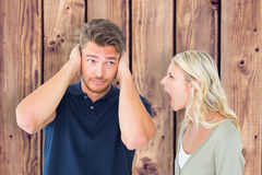 Composite image of man not listening to his shouting girlfriend Royalty Free Stock Photography