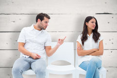 Composite image of man pleading with angry girlfriend Royalty Free Stock Photos