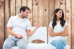 Composite image of man pleading with angry girlfriend Stock Image