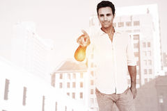 Composite image of man pointing at something on white background. Man pointing at something on white background  against low angle view of city buildings Stock Images