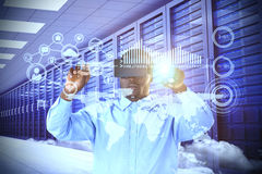 Composite image of man pointing while using virtual reality simulator Royalty Free Stock Photos