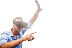 Composite image of man pointing while wearing virtual reality simulator Stock Image