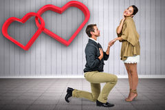 Composite image of man proposing woman while kneeling Royalty Free Stock Images