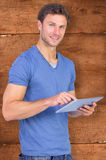 Composite image of man scrolling through tablet pc Royalty Free Stock Images
