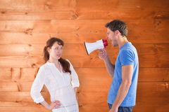 Composite image of man shouting through a megaphone Stock Image